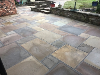 New Indian stone patio by Paul Gibbons Landscapes Ltd