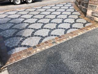 Driveway entrance way using granite cobbles